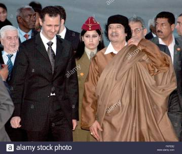 epa01298722-syrian-president-bashar-assad-l-walks-with-the-lybian-fkfe62